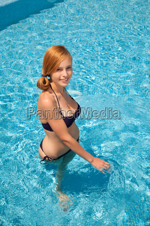 young woman in swimming pool high