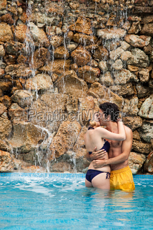 young couple embracing and kissing in