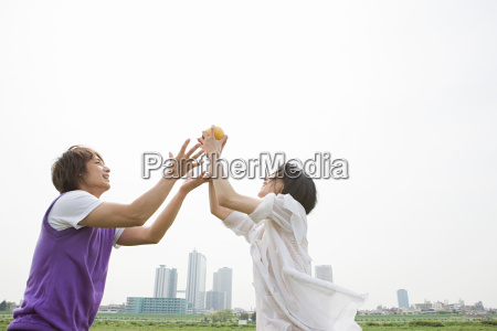 young couple playing ball game