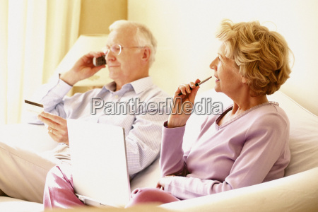 man on cellphone and woman using