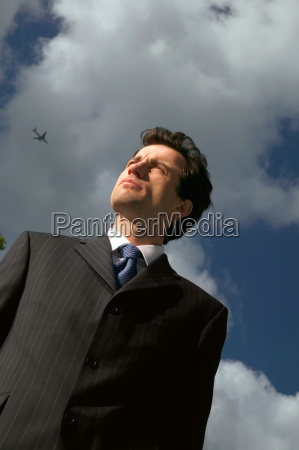 businessman and cloudy sky