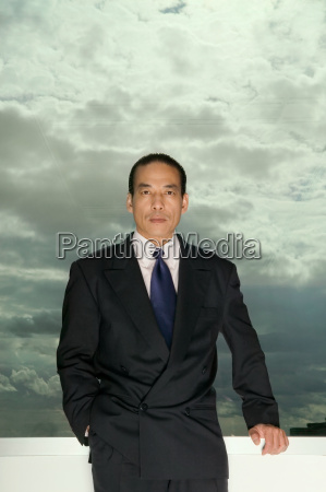 asian businessman and cloudy sky