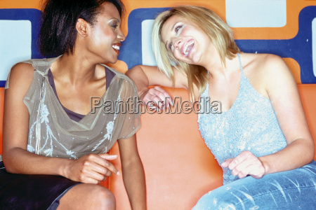 women chatting in nightclub