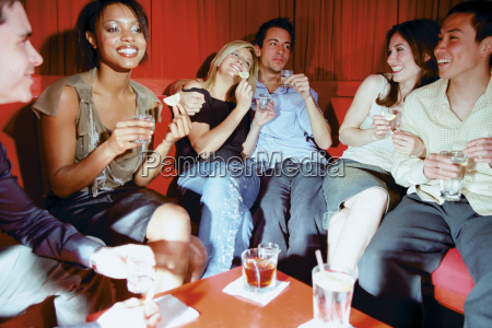 friends chatting in nightclub