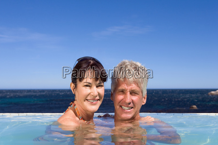 mature couple in swimming pool