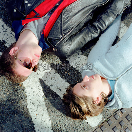 young couple lying down on the