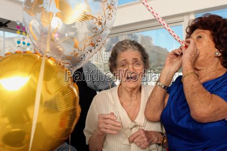 two elderly women celebrating