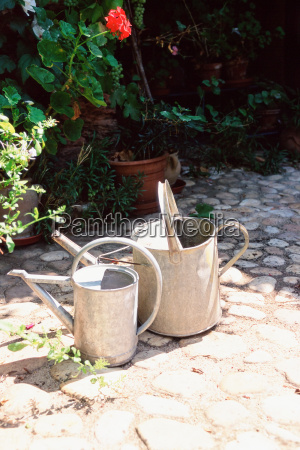 two metal watering cans