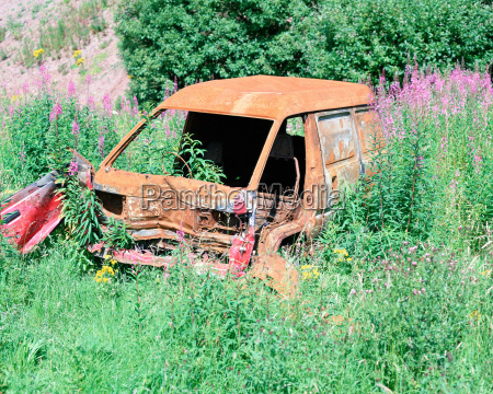 abandoned van in a field