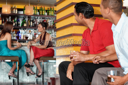 people sitting in bar
