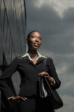 businesswoman and a cloudy sky