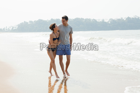 couple walking by the ocean
