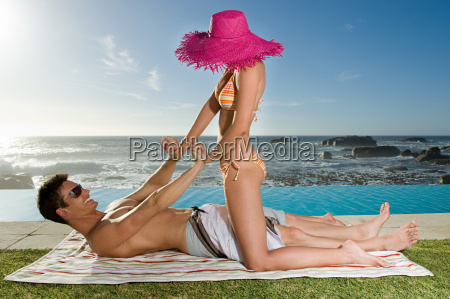 couple playfighting by the pool