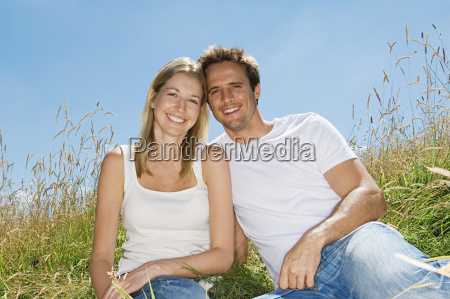 young couple in a field