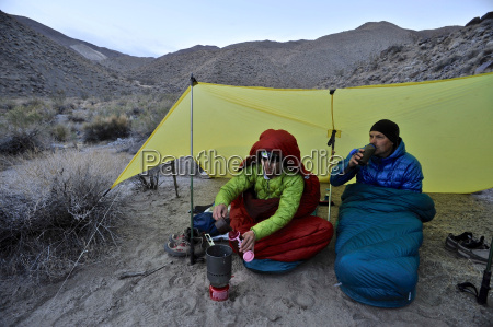 hikers camping in desert cottonwood canyon