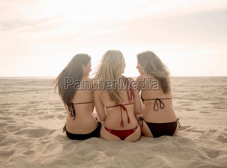 rear view of three women wearing