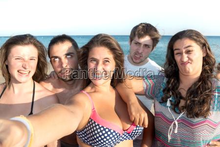 friends in summer taking a selfie