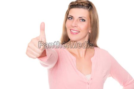 a mulher nova estica o polegar
