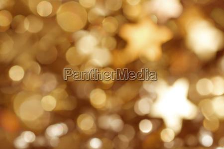 fundo dourado com estrelas e bokeh