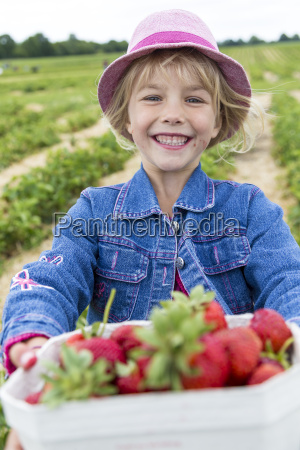 portrait of happy little girl holding