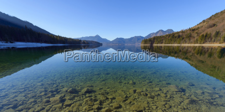 mountain landscape reflected in lake walchensee