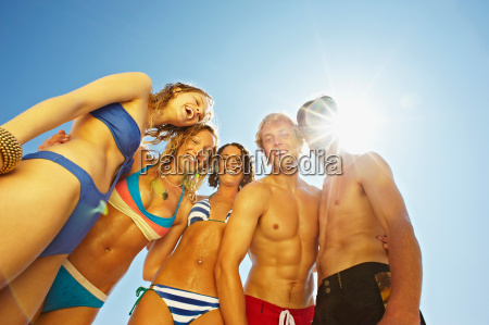 group of young people in swim