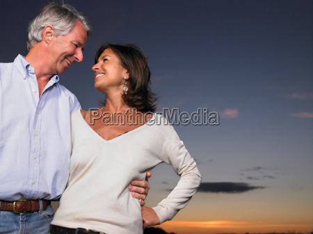 couple in a field by night