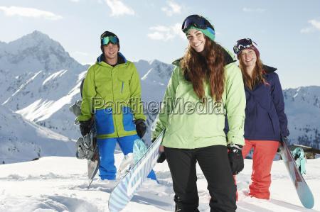 friends holding snowboards kuhtai austria