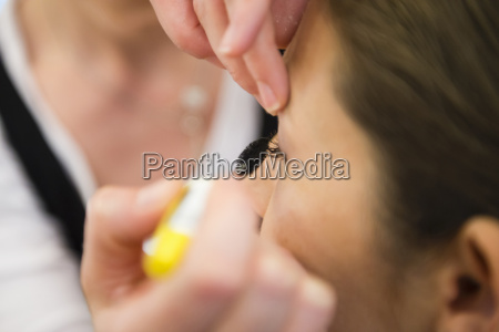 close up of woman applying brides