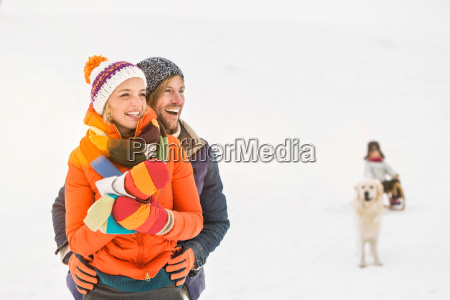couple in snow with girl and