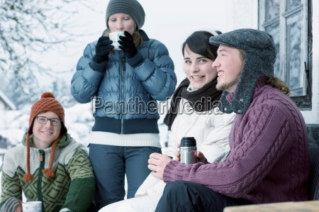 group of young people drinking warm