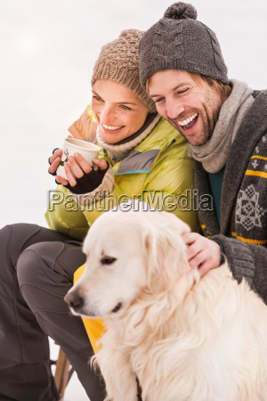 mid adult couple wearing knit hats