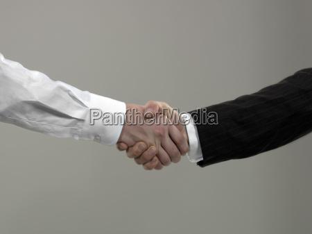 business men shaking hands close up