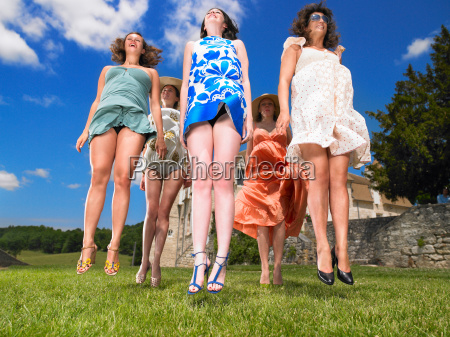 group of women jumping