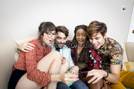 two young hipster couples sitting on