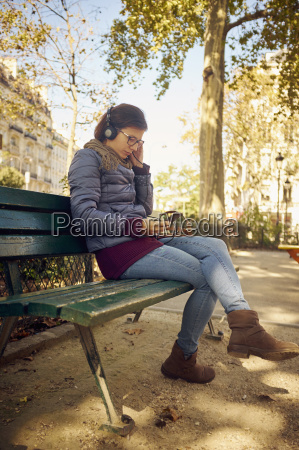 mid adult woman sitting in park