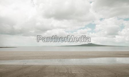 empty beach under cloudy sky