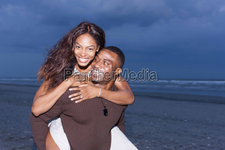 couple of beach man carrying woman