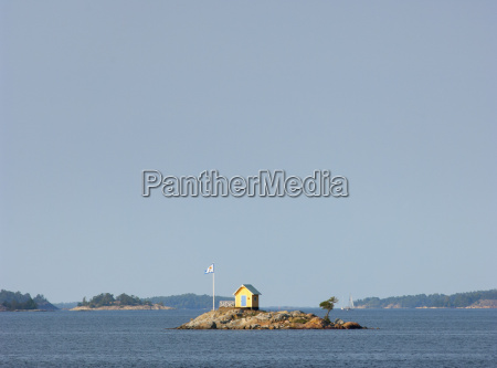 lone yellow hut in stockholms archipelago