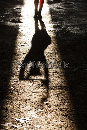 feet and shadow of young woman