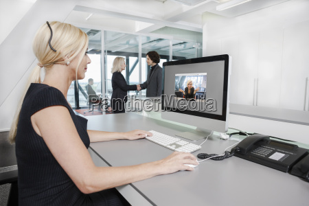 mid adult woman on video call