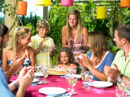 people celebrating a girls birthday