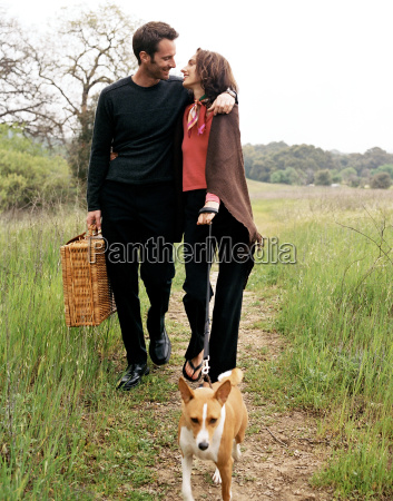 couple, walking, dog, in, countryside, with - 19502138