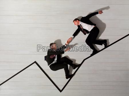 business men climbing up graph