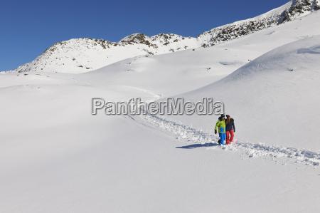 couple walking in snow kuhtai austria