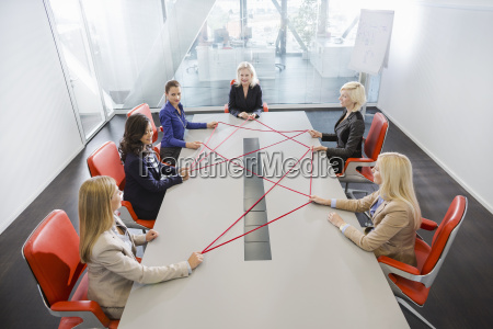 women problem solving at conference table