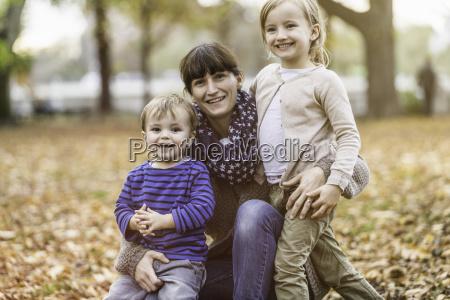 mother and children in park achenkirch