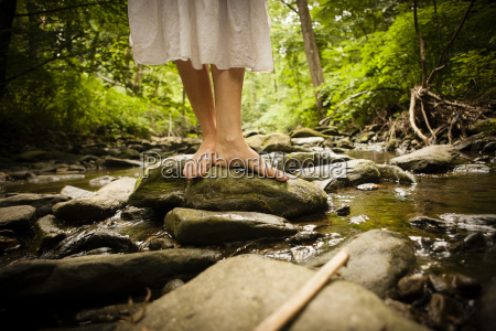 bare feet of mid adult woman