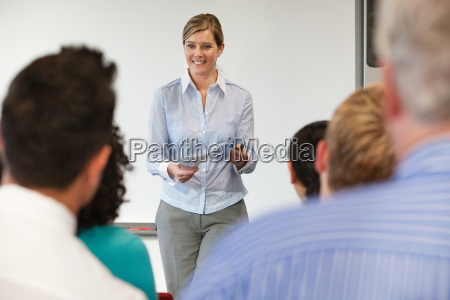 office worker training staff in meeting