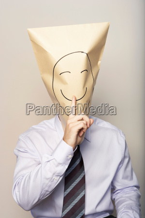 business man with paper bag on